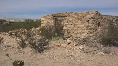 Texas-Terlingua-Stone-Ruin-With-Distant-Trading-Center-Zoom-In