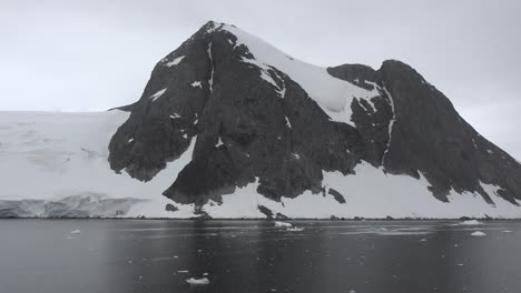 Antarctica-Lemaire-Channel-Black-Rock-With-Snow