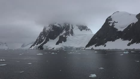 Antarctica-Lemaire-Passing-Horns-And-Glacier