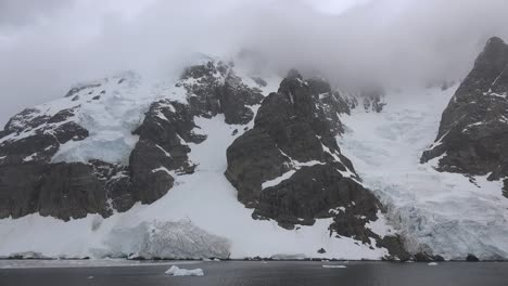 Antarctica-Lemaire-Snow-Tracks-Between-Rock-Horns