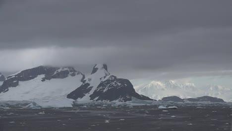 Antarctica-Lemaire-Sun-On-Distant-Mountains