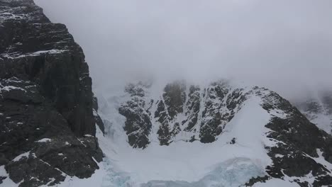 Antarctica-Lemaire-Tilts-Up-From-Snow