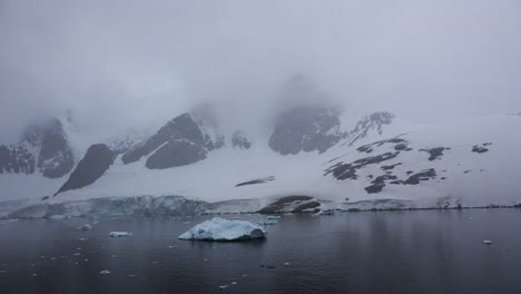 Antarctica-Lemaire-Towers-And-Little-Iceberg