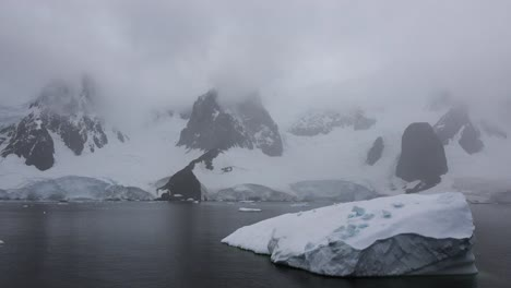 Antarctica-Lemaire-With-Passing-Iceberg