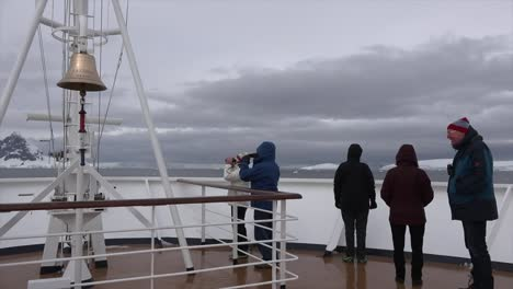 Antarctica-Bell-And-Tourists-On-Ship