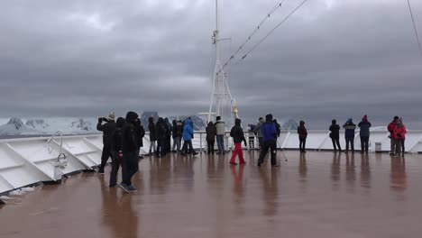 Antarctica-Cruise-Ship-Bow-People-Walking-Across-Zoom-And-Pan