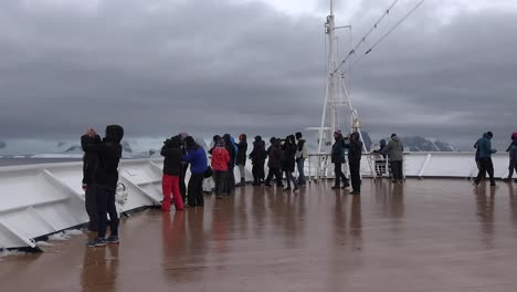 Antarctica-Cruise-Ship-Bow-With-People-Zoom-Out