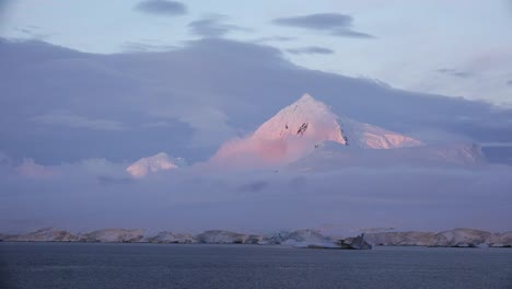 Antarctica-Evening-Color-On-Snowy-Mountain
