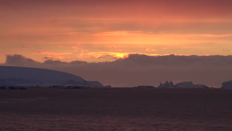 Antarctica-Sailing-Past-Ice-At-Sunset