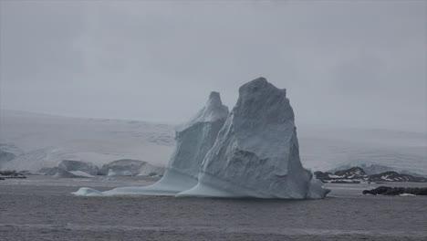 Antarctica-Tall-Icebergs-Floating-In-Sea