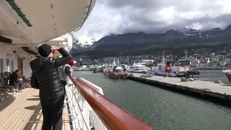 Argentina-Ushuaia-Woman-On-Ship-Looks-At-Dock