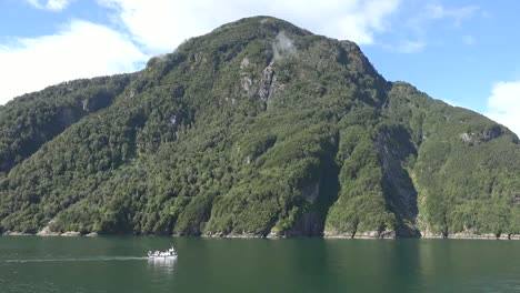 Chile-Aisen-Fjord-Boat-Passes-Mountain
