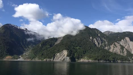 Chile-Aisen-Fjord-Clouds-On-Rugged-Mountains
