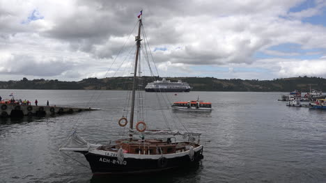 Chile-Chiloe-Castro-Sailboat-With-Cruise-Ship-Tender