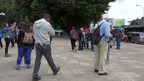 Chile-Chiloe-Castro-Tourists-In-Plaza