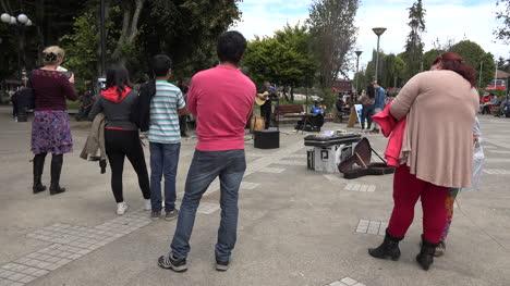 Chile-Chiloe-Castro-Tourists-Standing-In-Plaza