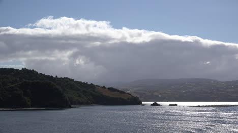 Chile-Estero-De-Castro-Cloud-And-Sun-On-Water