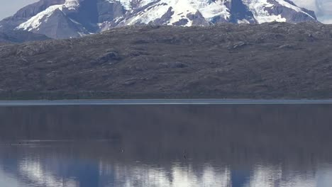 Chile-Mount-Burney-Passing-By-Reflections-Pans-Tilt-Down