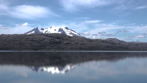 Chile-Mount-Burney-Reflections-Of-Volcano-With-Bird