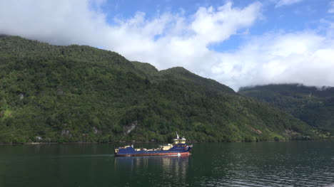 Chile-Puerto-Chacabuco-Work-Boat-Passes-Hills