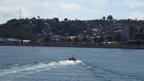 Chile-Puerto-Montt-Tender-Leaves-With-Wake