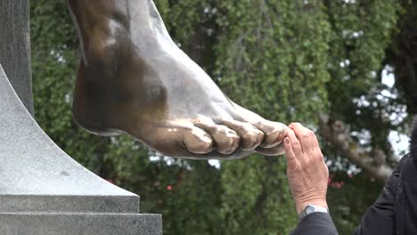 Chile-Punta-Arenas-Hand-On-Toe-Of-Indian-Statue