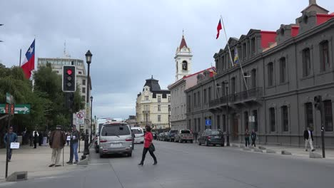 Chile-Punta-Arenas-Woman-In-Red-Crosses-Street