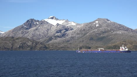 Chile-Strait-Of-Magellan-Freighter-Passes-Peak-With-Snow