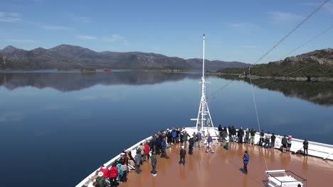 Chile-Passengers-Gather-Along-A-Railing-To-Look-At-Ship-Wreck