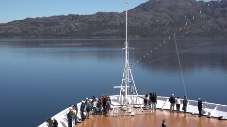 Chile-Passengers-On-Bow-Of-Cruise-Ship