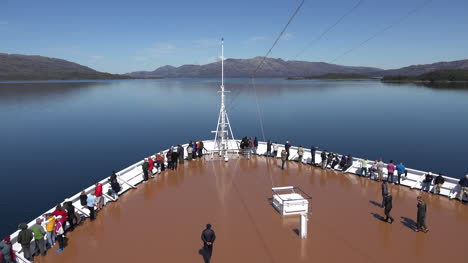 Chile-Passengers-On-Bow-Of-Ship