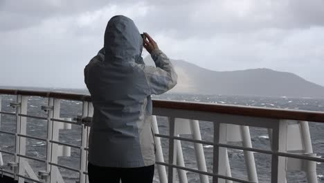 Chile-Woman-Photographs-Cape-Horn-From-Ship