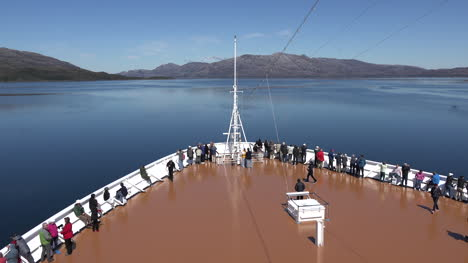 Chile-Zooms-On-Front-Of-Ship-Bow-In-Fjord