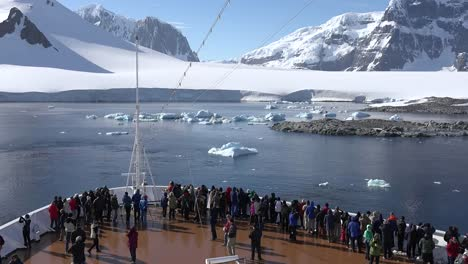 Antarctica-Neumayer-Channel-Passengers-Gather-On-Bow-Of-Ship