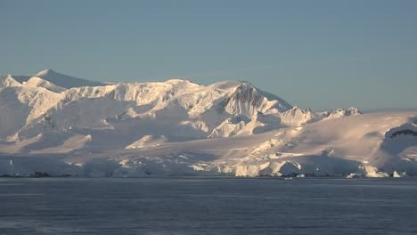 Antarctica-A-Snowy-Coastline-In-Early-Morning-Light