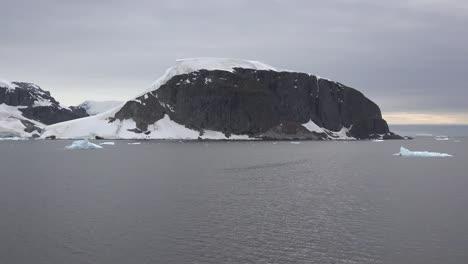 Antarctica-Black-Rock-Rising-From-Water