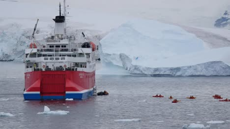 Antarctica-Expedition-Ship-And-Little-Kayaks