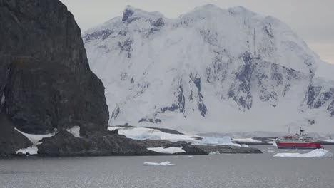 Antarctica-Expedition-Ship-And-White-Mountain
