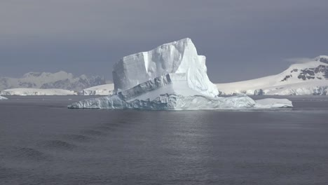 Antarctica-Floating-Iceberg-And-Ripples