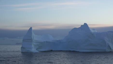 Antarctica-Floating-Iceberg-At-Dawn