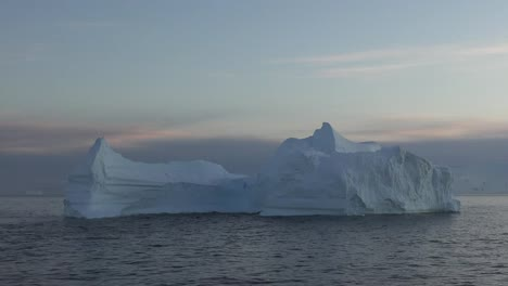 Antarctica-Floating-Iceberg-In-Morning-Pans-And-Zooms