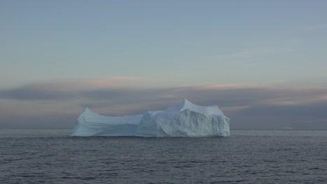 Antarctica-Iceberg-Floating-At-Dawn