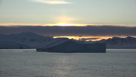 Antarctica-Iceberg-Floating-By-At-Dawn