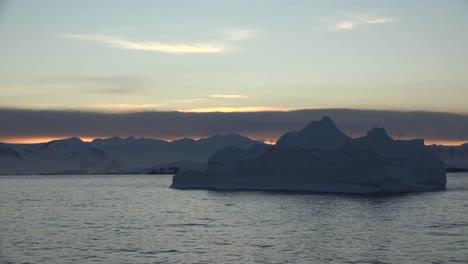 Antarctica-Iceberg-Floats-At-Dawn