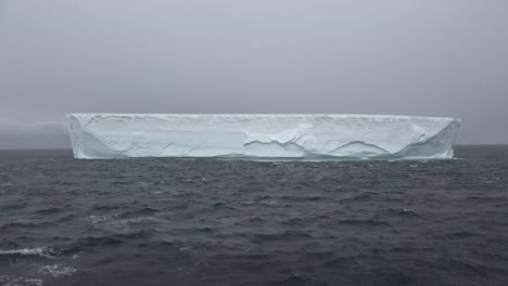 Antarctica-Iceberg-From-An-Ice-Shelf-Floats-By