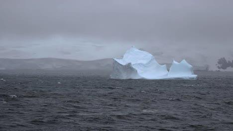 Antarctica-Iceberg-In-Foggy-Scene