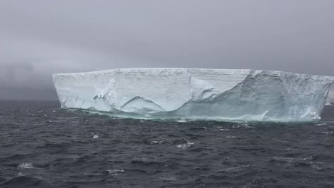 Antarctica-Pans-And-Zooms-Out-On-Iceberg