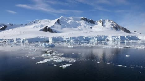 Antarctica-Passing-Ice-Flows-And-Mountain