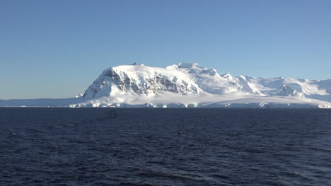 Antarctica-Snowy-Mountain-And-Blue-Sky-Zoom-In