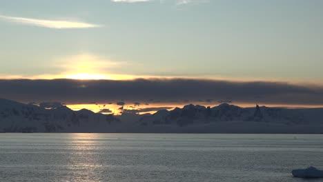 Antarctica-Sunrise-Pan-And-Zoom-To-Sun-Tilts-Down